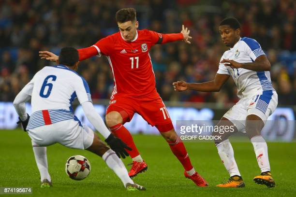 Wales' striker Tom Lawrence vies with Panama's midfielder Manuel Vargas and Panama's midfielder Armando Cooper during the international friendly...