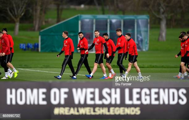 Wales strikers Hal Robson Kanu and Sam Vokes make thie way to training with team mates during a Wales Open Training session ahead of their World Cup...