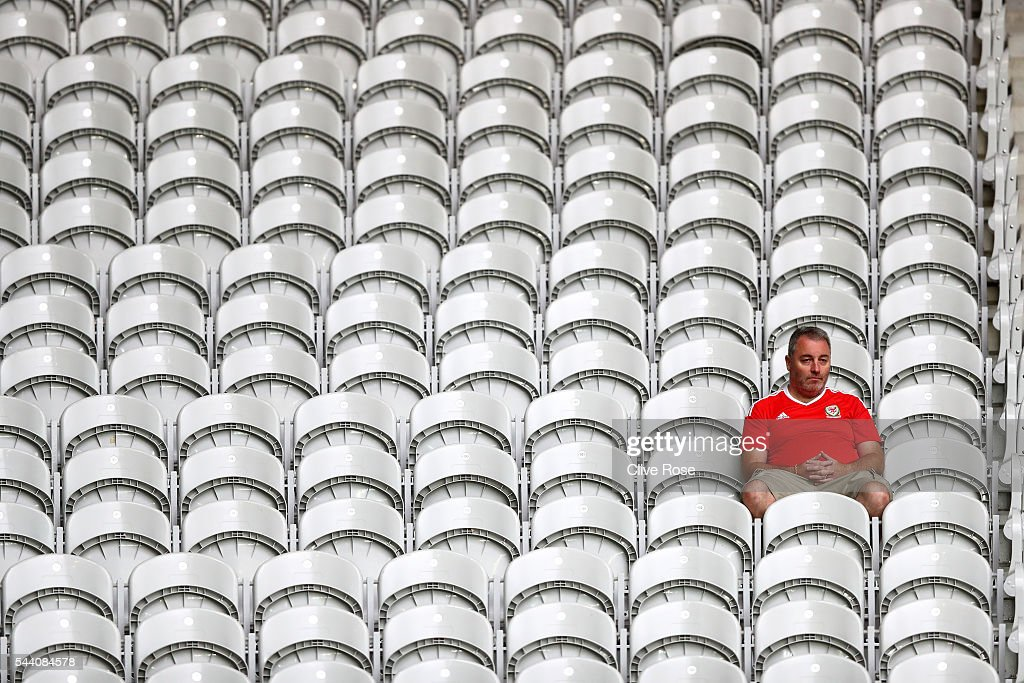 A Wales supporter is seen in the stand prior to the UEFA EURO 2016 quarter final match between Wales and Belgium at Stade Pierre-Mauroy on July 1, 2016 in Lille, France.
