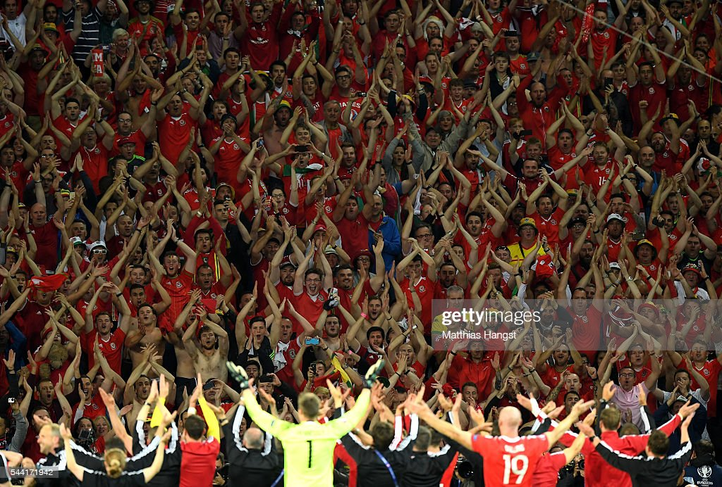 Wales supporters celebrate their team's win after UEFA EURO 2016 quarter final match between Wales and Belgium at Stade Pierre-Mauroy on July 1, 2016 in Lille, France.