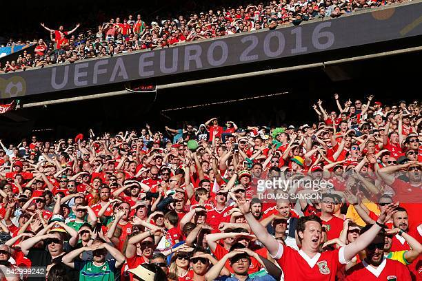 TOPSHOT Wales supporters cheer during the Euro 2016 round of sixteen football match Wales vs Northern Ireland on June 25 2016 at the Parc des Princes...