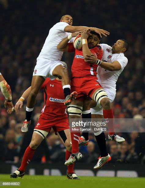Wales' Taulupe Faletau and England's Mike Brown and Luther Burrell