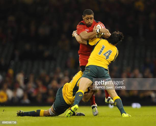 Wales' Taulupe Faletau is tackled by Australia's Adam AshleyCooper and Rob Simmons