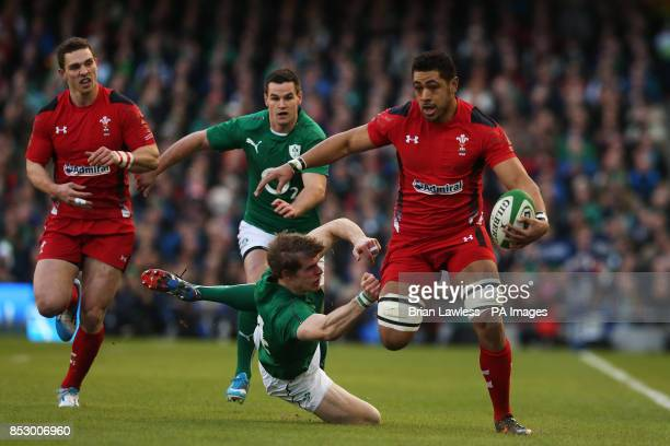 Wales' Taulupe Faletau is tackled by Ireland's Andrew Trimble during the RBS 6 Nations match at the Aviva Stadium Dublin Ireland
