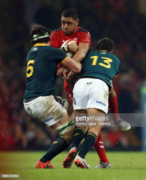 Wales Taulupe Faletau is tackled by South Africa's Marcell Coetzee and Jan Serfontein