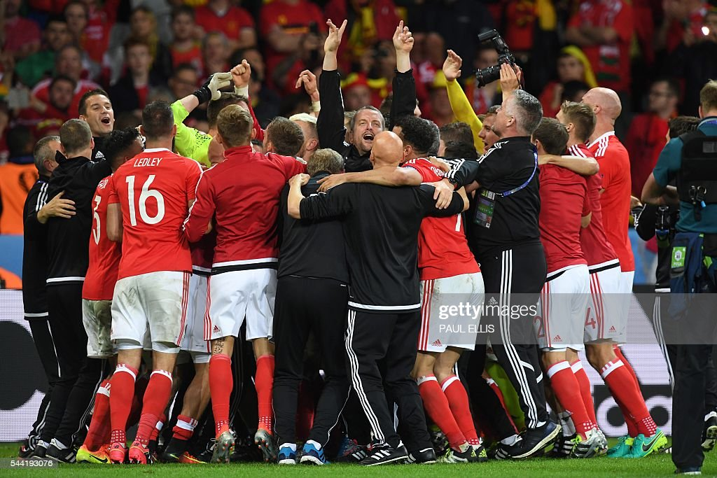 Wales' team celebrates after the Euro 2016 quarter-final football match between Wales and Belgium at the Pierre-Mauroy stadium in Villeneuve-d'Ascq near Lille, on July 1, 2016. Wales won the match 3-1. / AFP / PAUL