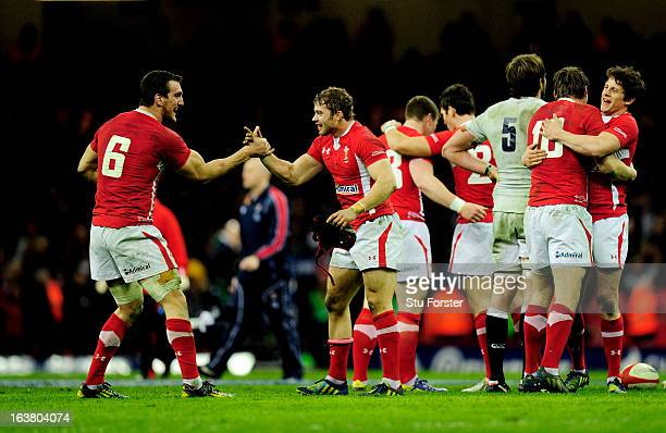 Wales teammates Sam Warburton and Leigh Halfpenny celebrate winning the Six Nations championship as the final whistle blows during the RBS Six...