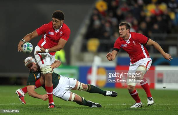 Wales' Toby Faletau in action with South Africa's Heinrich Brussow