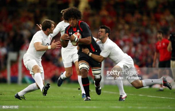 Wales' Toby Faletau is caught by England's Mark Cueto and Ben Foden during the Investec International at the Millennium Stadium Cardiff