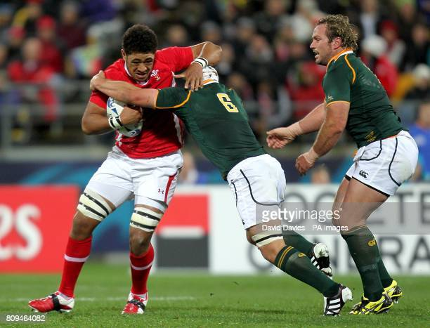Wales' Toby Faletau is challenged by South Africa's Heinrich Brussow