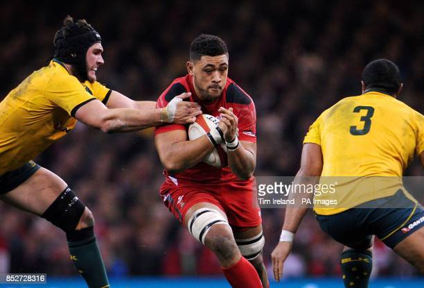 Wales' Toby Faletau is tackled by Australia's Rob Simmons and Australia's Sekope Kepu during the Dove Men Series at the Millennium Stadium Cardiff