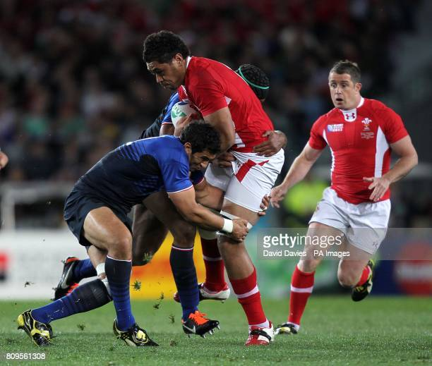Wales' Toby Faletau is tackled by France's Maxime Mermoz