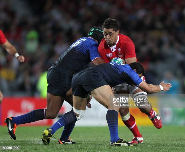 Wales' Toby Faletau is tackled by France's Thierry Dusautoir and Maxime Mermoz