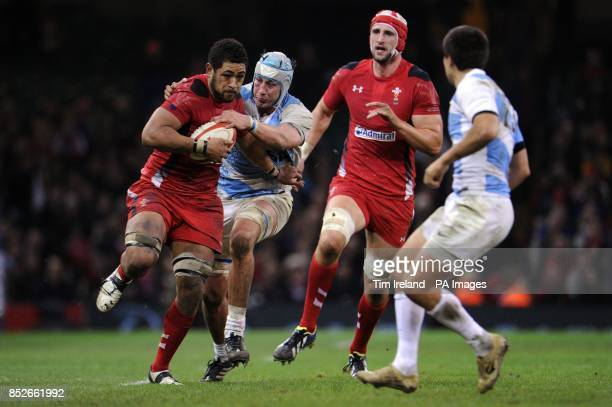 Wales' Toby Faletau is tackled during the Dove Men Series match at the Millennium Stadium Cardiff