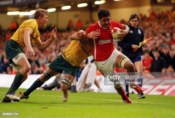 Wales' Toby Faletau is tackled short of the line by Australia's Lachie Turner and David Pocock during the International match at the Millennium...
