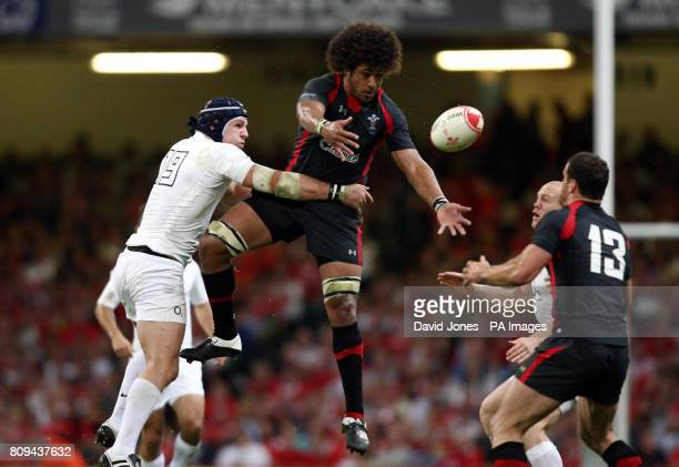 Wales' Toby Faletau secure a high ball under pressure from England's James Haskell during the Investec International at the Millennium Stadium Cardiff