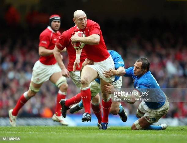 Wales' Tom Shanklin breaks through the tackle of Italy's Sergio Parisse during the RBS 6 Nations match at the Millennium Stadium Cardiff