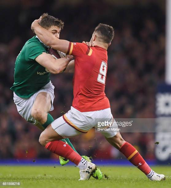 Wales United Kingdom 10 March 2017 Garry Ringrose of Ireland is tackled by Rhys Webb of Wales during the RBS Six Nations Rugby Championship match...