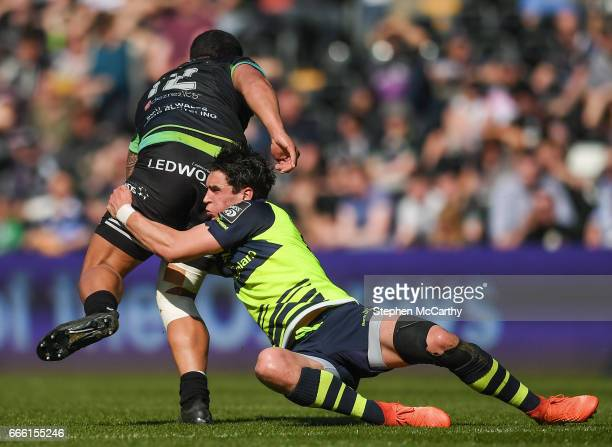 Wales United Kingdom 8 April 2017 Joey Carbery of Leinster tackles Josh Matavesi of Ospreys during the Guinness PRO12 Round 19 match between Ospreys...
