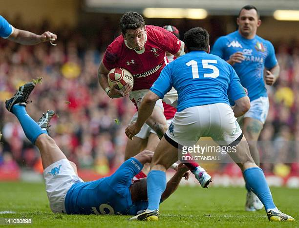 Wales wing Alex Cuthbert is tackled by Italy's fullback Andrea Masi during the Six Nations International rugby union match between Wales and Italy at...