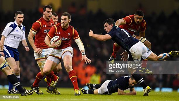Wales wing George North breaks the tackle of John Hardie on his way to scoring his try during the RBS Six Nations match between Wales and Scotland at...