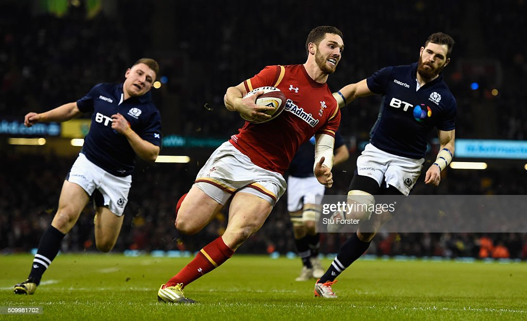 Wales wing <a gi-track='captionPersonalityLinkClicked' href=/galleries/search?phrase=George+North&family=editorial&specificpeople=7320853 ng-click='$event.stopPropagation()'>George North</a> crosses for his try during the RBS Six Nations match between Wales and Scotland at Principality Stadium on February 13, 2016 in Cardiff, Wales.