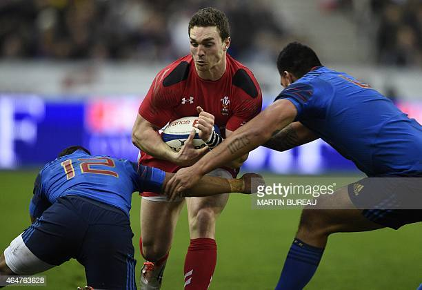 Wales' wing George North is tackled by France's centre Wesley Fofana and France's lock Romain Taofifenua during the Six Nations international rugby...