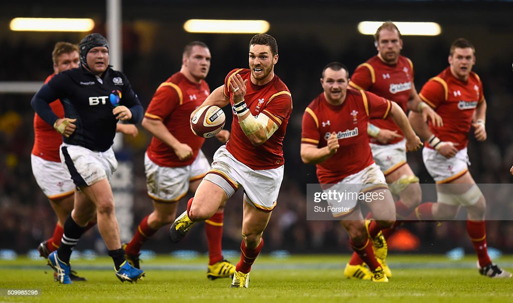 Wales wing <a gi-track='captionPersonalityLinkClicked' href=/galleries/search?phrase=George+North&family=editorial&specificpeople=7320853 ng-click='$event.stopPropagation()'>George North</a> makes a break for his try during the RBS Six Nations match between Wales and Scotland at Principality Stadium on February 13, 2016 in Cardiff, Wales.