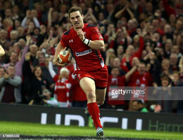 Wales wing George North runs in to score a try during the Six Nations international rugby union match between Wales and Scotland at the Millennium...