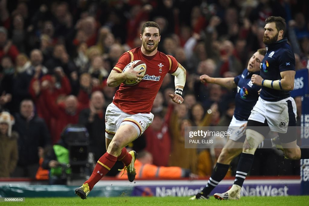 Wales' wing George North runs in to score a try during the Six Nations international rugby union match between Wales and Scotland at the Principality Stadium in Cardiff, south Wales, on February 13, 2016. / AFP / PAUL ELLIS / RESTRICTED TO EDITORIAL USE. Use in books subject to Welsh Rugby Union (WRU) approval.