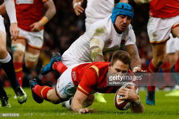 Wales' wing Liam Williams scores a try during the Six Nations international rugby union match between Wales and England at the Principality Stadium...