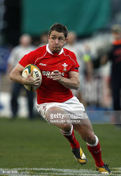 Wales wing Shane Williams runs on his way to score a try during the first Test match between South Africa and Wales at the Vodacom park rugby stadium...