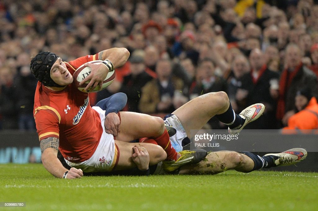 Wales' wing Tom James (L) is tackled by Scotland's centre Duncan Taylor (R) just before the try line during the Six Nations international rugby union match between Wales and Scotland at the Principality Stadium in Cardiff, south Wales, on February 13, 2016. / AFP / PAUL ELLIS / RESTRICTED TO EDITORIAL USE. Use in books subject to Welsh Rugby Union (WRU) approval.