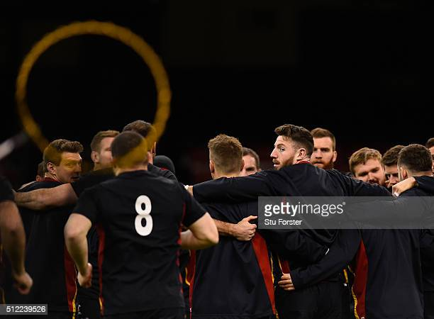 Wales winger Alex Cuthbert looks on in a team huddle during the Wales captain's run ahead of their RBS Six Nations match against France at...