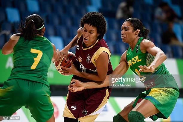 Waleska Perez of Venezuela drives the ball against Palmira Marcal and Iziane Castro of Brazil during International Womens Basketball Tournament...