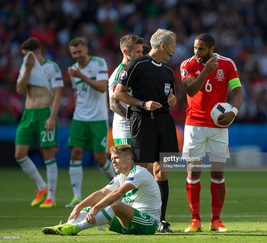 Wales's Ashley Williams protests to Referee Martin Atkinson after a decision against his team during the UEFA Euro 2016 Round of 16 match between Wales and Northern Ireland at Parc des Princes on June 25 in Paris, France.