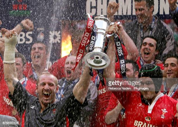 Wales's captains Gareth Thomas and Michael Owen hold the RBS 6 Nations Trophy after defeating Ireland