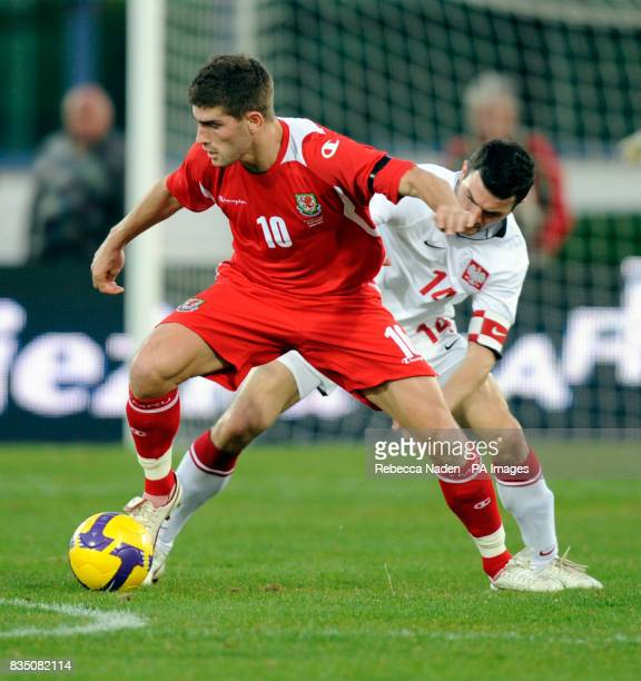 Wales's Ched Evans and Poland's Michael Zewlakow battle for the ball