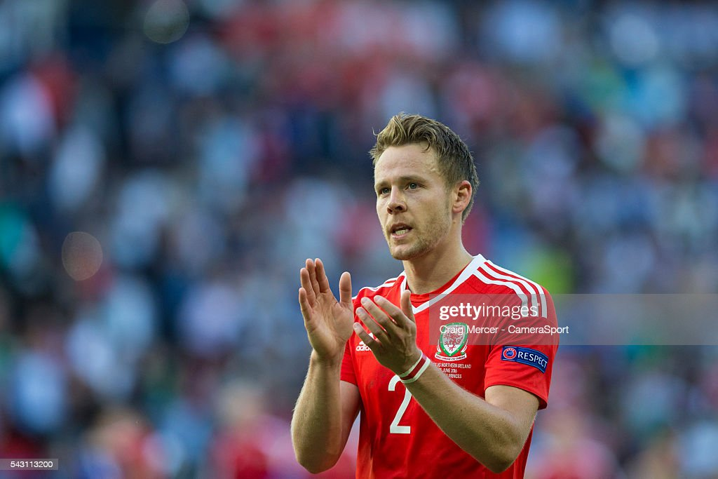 Wales's Chris Gunter applauds the fans at full time during the UEFA Euro 2016 Round of 16 match between Wales and Northern Ireland at Parc des Princes on June 25 in Paris, France.