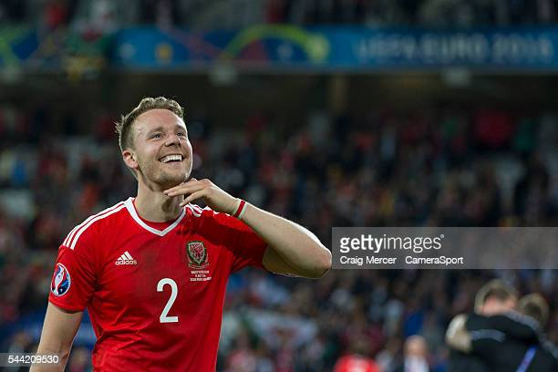 Wales's Chris Gunter celebrates at full time during the UEFA Euro 2016 Quarterfinal match between Wales and Belgium at Stade Pierre Mauroy on July 01...