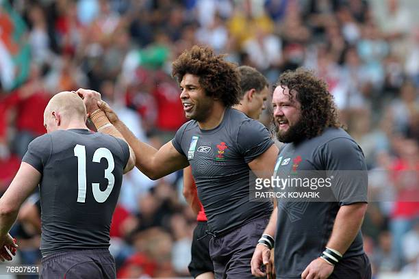 Wales's flanker Colin Charvis jubilates after scoring a try with teammates Wales's centre Tom Shanklin and Wales's prop Adam Jones during the rugby...