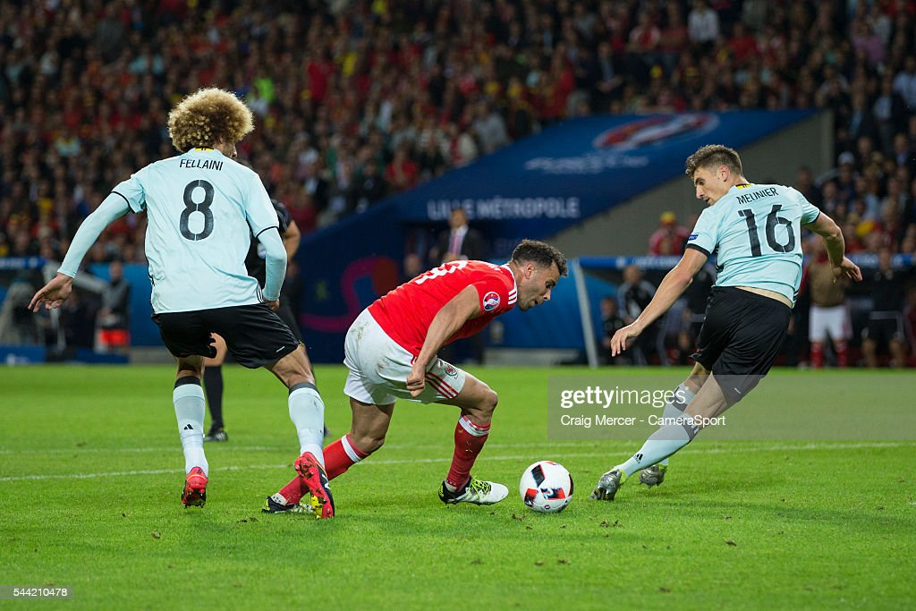 Wales's <a gi-track='captionPersonalityLinkClicked' href=/galleries/search?phrase=Hal+Robson-Kanu&family=editorial&specificpeople=5776956 ng-click='$event.stopPropagation()'>Hal Robson-Kanu</a> turns inside Belgium's <a gi-track='captionPersonalityLinkClicked' href=/galleries/search?phrase=Marouane+Fellaini&family=editorial&specificpeople=3936316 ng-click='$event.stopPropagation()'>Marouane Fellaini</a> and Belgium's <a gi-track='captionPersonalityLinkClicked' href=/galleries/search?phrase=Thomas+Meunier&family=editorial&specificpeople=8330376 ng-click='$event.stopPropagation()'>Thomas Meunier</a> on his way to scoring his side's second goal during the UEFA Euro 2016 Quarter-final match between Wales and Belgium at Stade Pierre Mauroy on July 01 in Marseille, France.