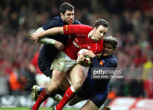 Wales's Mark Jones breaks clear of France's Julien Malzieu and Cedric Heymans during the RBS 6 Nations match at the Millennium Stadium Cardiff