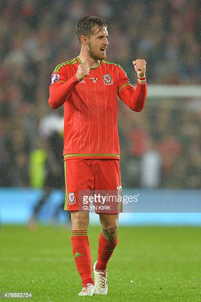 Wales's midfielder Aaron Ramsey gestures to the crowd after the final whistle of the Euro 2016 qualifying group B football match between Wales and...