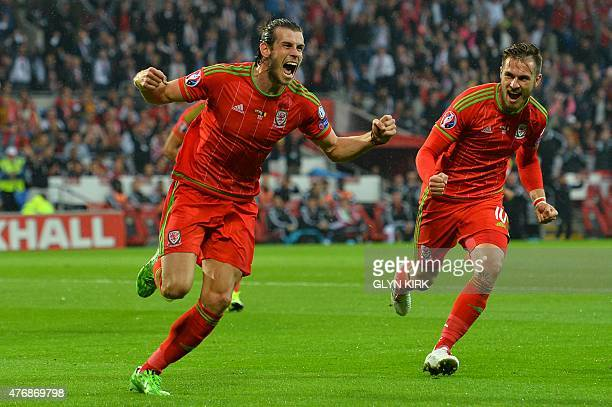 Wales's midfielder Gareth Bale celebrates scoring the opening goal with Wales's midfielder Aaron Ramsey during the Euro 2016 qualifying group B...