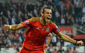Wales's midfielder Gareth Bale celebrates scoring the opening goal during the Euro 2016 qualifying group B football match between Wales and Belgium...