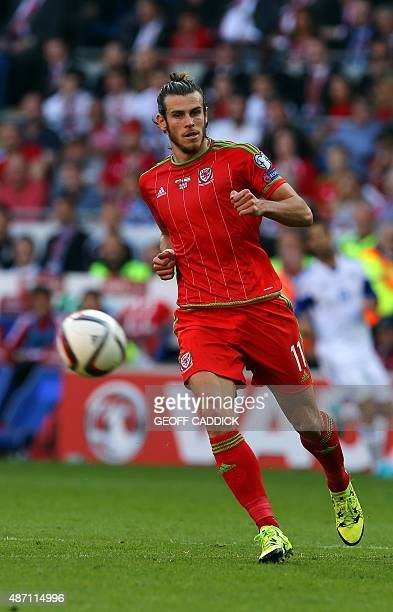 Wales's midfielder Gareth Bale chases the ball during the Euro 2016 qualifying group B football match between Wales and Israel at Cardiff City...