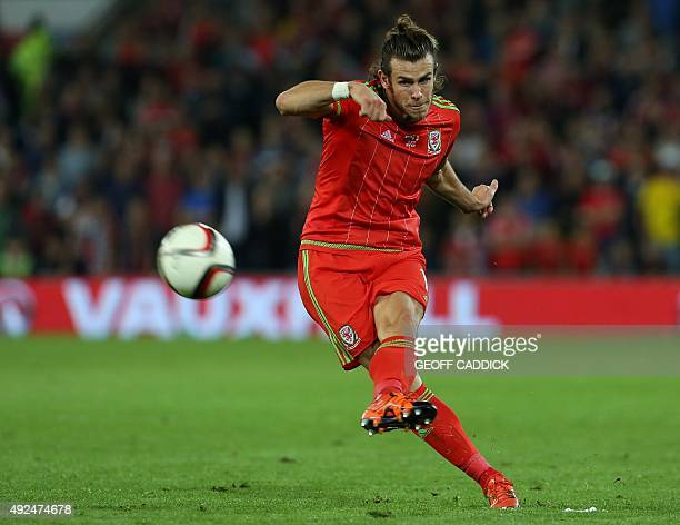 Wales's midfielder Gareth Bale strikes the ball as he takes a freekick during the Euro 2016 qualifying football match between Wales and Andorra at...