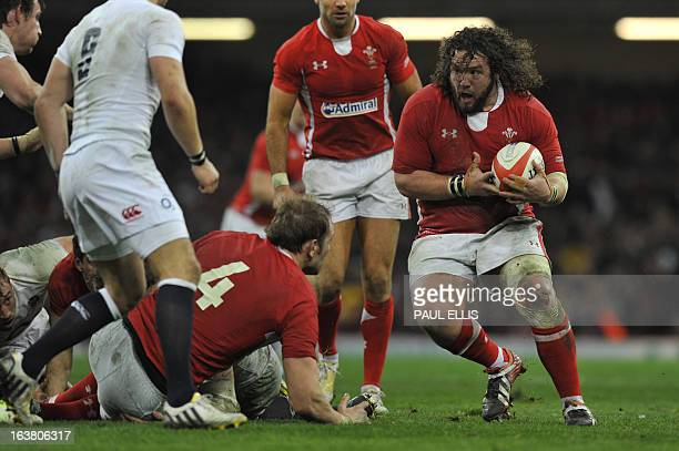 Wales's prop Adam Jones runs with the ball during the Six Nations international rugby union match between Wales and England at the Millennium Stadium...