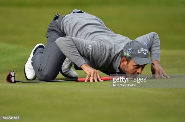 TOPSHOT Wales's Stuart Manley Lines up a putt on the 8th green during his opening round on the first day of the Open Golf Championship at Royal...